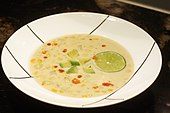 Corn chowder with avocado and lime