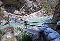 Crossing a hanging bridge - Annapurna Circuit, Nepal - panoramio.jpg