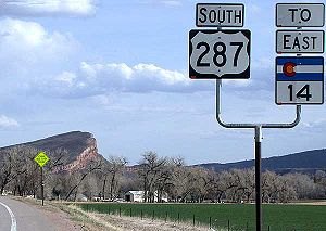 Colorado State Highway 14 - SH 14, here concurrent with US 287, north of Bellvue at Teds Place. Goat Hill near Bellvue can be seen in the background.