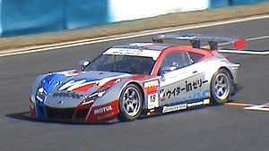 2010 Super GT Series - The No. 18 Weider Honda Racing Honda HSV-010 GT of Takashi Kogure and Loïc Duval at the Okayama round of the season. Despite winning only one race, Kogure and Duval each claimed their first Super GT championship. Weider Honda also won the GT500 Teams title, ahead of Team TOM'S.