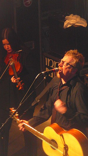 Dave King (Irish singer) - Dave King and his wife, Bridget Regan, performing with Flogging Molly in 2010