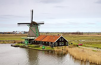 De Zoeker, an oil windmill built in 1672 and still in operation, located in Zaanstad, Netherlands.