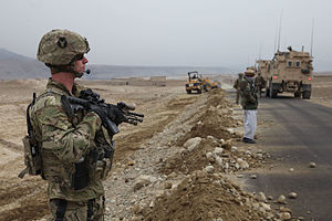 2nd Infantry Brigade Combat Team, 34th Infantry Division - 1-113th Cavalry provides security for soldiers talking to villagers, Parwan province, Afghanistan, 13 January 2011.