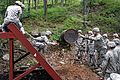 Defense.gov News Photo 110614-A-XXXXS-013 - An Army cadet tosses an empty 55-gallon drum to another cadet during the leader reaction course at the U.S. Military Academy at West Point N.Y..jpg