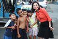 Deputy Court Administrator Nimfa Cuesta Vilches with Filipino children.jpg