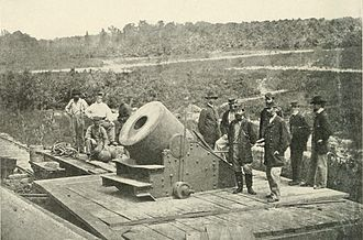 "Siege of Petersburg - The ""Dictator"" siege mortar at Petersburg. In the foreground, the figure on the right is Brig. Gen. Henry J. Hunt, chief of artillery of the Army of the Potomac."