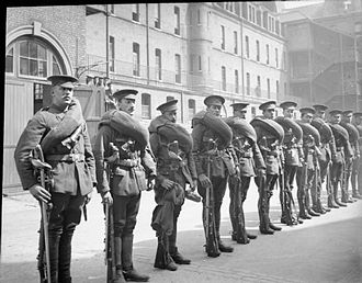 British cavalry during the First World War - A dismounted section from the 1st Life Guards in 1914. Note the cavalry ammunition bandoliers and the swords, carried on their belts.