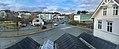 Distorted (compressed) panorama of Leirvik, Stord, Norway, seen from Grand Hotell. Stord town hall, bus station, Esso petrol station, Heimebaserte tenester, Vikabrekko (fylkesveg 544) etc. 2018-03-09.jpg