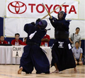 Dong Jin Kim sensei (back facing camera) in the 2008 Kendo championship match vs. Mikio Koga sensei.png