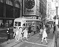 Downtown Cincinnati in 1940s - looking NE at 5th & Vine with streetcar and Kahn's clock.jpg