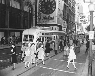 Vine Street, Cincinnati - Busy scene on Vine at 5th circa the early 1940s, with streetcar and Kahn's clock. Every building depicted in the photo has since been demolished.