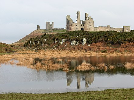 Dunstanburgh Castle, reflected in the remains of the southern mere Dunstanburgh Castle - geograph.org.uk - 1716666.jpg