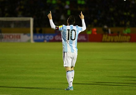After blessing himself, Messi often celebrates a goal by pointing a finger on each hand towards the sky in dedication to his late grandmother. His goal celebration features in the FIFA video game series, first appearing in FIFA 14 ECUADOR VS ARGENTINA (36956136633).jpg