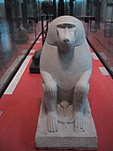 Egyptian statue of a baboon at the Louvre museum.jpg