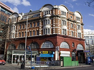 Elephant & Castle tube station - The Bakerloo line entrance, showing its design features with shops and the entrance to the far right
