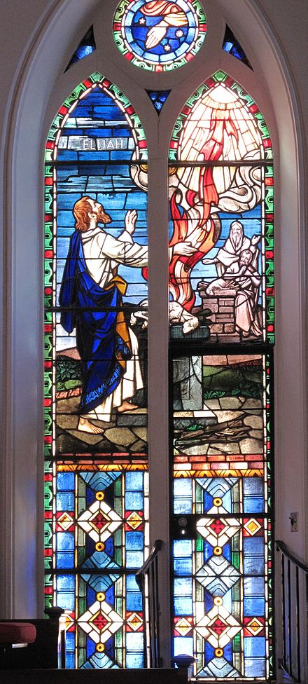 Elijah's offering is consumed by fire from heaven in a stained glass window at St. Matthew's German Evangelical Lutheran Church in Charleston, South Carolina. Elijahwindow.jpg