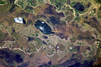 Iberá Wetlands - Some lakes in the Iberá Wetlands, reflecting sunlight. Photographed from the International Space Station.