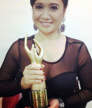 Eugene Domingo - Domingo accepting Best Actress Award at the 25th Aliw Awards in 2012
