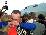 Expedition 24 commander Skvortsov greeted by wife and daughter.jpg