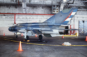 Cuban Revolutionary Air and Air Defense Force - A left side view of a Cuban MIG-21 fighter aircraft inside VF-45 hangar.