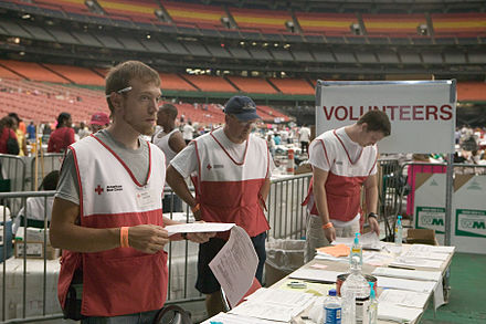 Volunteers assist Hurricane victims at the Houston Astrodome, following Hurricane Katrina. FEMA - 15337 - Photograph by Andrea Booher taken on 09-10-2005 in Texas.jpg