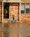 FEMA - 34476 - Missouri residents wait for rescue at a flooded house.jpg