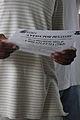 FEMA - 38105 - An evacuee holds a FEMA flier in Louisiana.jpg