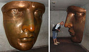 Full-size replica of the face of the Statue, seen as part of the exhibit in one of the corridors of the Statue's pedestal. Note the retention of the original copper color.
