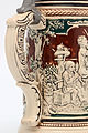 Faience beer stein with ball scene on brown background 20.jpg