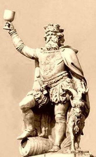 Gambrinus - A statue of Gambrinus holding a chalice aloft, with his right foot atop a beer keg, and a goat to his left. Falstaff brewery in New Orleans