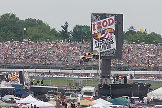 2011 Indianapolis 500 - Tanner Foust from Team Hot Wheels sped down a 90-foot ramp, suspended on a 10-story high door and jumped across the Indianapolis Motor Speedway's infield inside the fourth turn.
