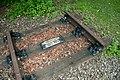 Former High Royds Hospital Railway trackbed with commemorative section of track.jpg