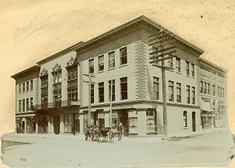 The Joplin Globe - View of exterior of Fourth Street, between Main and Virginia, showing Pacific Express Company, Y.M.C.A. and Joplin Daily Globe. The State Historical Society of Missouri.