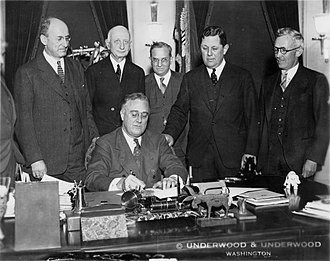 Gold Reserve Act - President Franklin Delano Roosevelt signs the bill into law in 1934.
