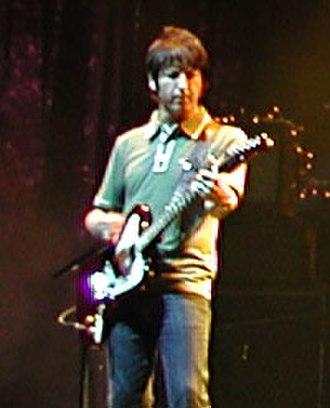 Oasis (band) - Guitarist Gem Archer performing at an Oasis concert.