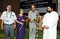 Ghulam Nabi Azad lighting the lamp to inaugurate the National Summit on Non-communicable Diseases, in New Delhi. The Minister of State for Health and Family Welfare, Shri Sudip Bandyopadhyay is also seen.jpg