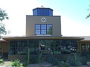 photo of the administrative building of the Thunderbird School of Global Management, featuring the historical control tower from the 1940s airfield on which it was built.