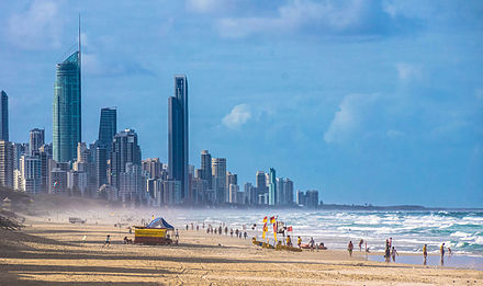 Australia has one of the world's most highly urbanised populations with the majority living in metropolitan cities on the coast. (Pictured: Gold Coast beach and skyline, Queensland.) Gold Coast skyline.jpg