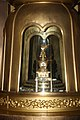 Golden Buddha in shrine with 10,000 Buddhas.jpg