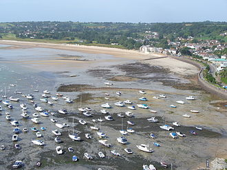 The harbour of Gorey, Jersey falls dry at low tide. Gorey Harbour at low tide.JPG