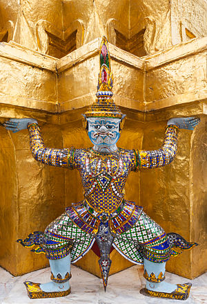 "Yaksha (mysthical demon) ""lifting"" the southern of the Two Golden Phra Chedis (or pagodas) located on the Phaithee terrace in the Wat Phra Kaew (or Temple of the Emerald Buddha) in Bangkok, Thailand. The chedis were constructed by order of King Rama I in honor of his father (southern pagoda) and mother (northern pagoda) at the end of the 18th century. The structures are entirely covered with copper sheets, painted with lacquer and covered with gold leaf. The 20 demons and monkeys around the base were added later, at the end of the 19th century, by order of King Rama V."