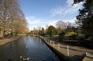 Grove Park (Sutton) - Grove Park, Carshalton. View north from the Portland stone bridge, showing the river Wandle passing through an artificial channel. The Grove house can just be seen to the right.