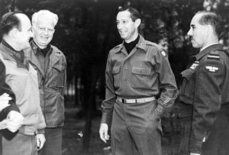 Mark W. Clark - From left to right, Alfred Gruenther, Donald W. Brann, Mark W. Clark, and Guy Garrod.
