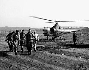 VMO-6 - Navy Corpsmen help carry a wounded man from a VMO-6 HO3S-1 helicopter to a hospital in Korea in October 1950.