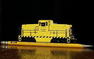 Rail transport modelling - HO scale (1:87) model of a North American center cab switcher shown with a pencil for size.