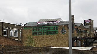 Hackney Wick - Old industrial buildings now used as artist studios. teeth-and-gums rooftop graffiti by Sweet Toof.