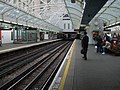 Hammersmith (District) station westbound Piccadilly look east.JPG