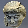 Head of a female worshiper from the Temple of Ishtar at Nineveh, Iraq. 700-625 BCE. British Museum.jpg