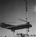 Helicopter servicing the Mid-Canada Line.jpg