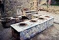 Herculaneum - Bottega dei Cereali (4779279093).jpg
